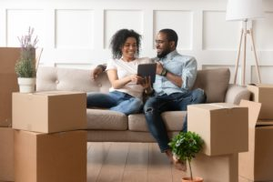 Two people search for rental properties on an iPad or tablet.