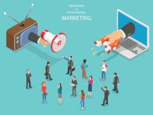 A cartoon representation of inbound and outbound marketing. Inbound marketing features a magnet attracting a group, outbound marketing features a bullhorn announcing at the group.